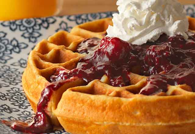 Buttermilk waffles with mixed berry suace