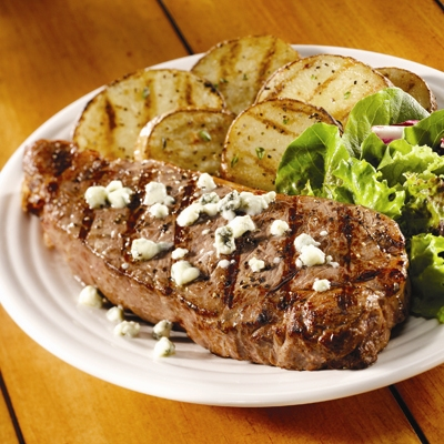Blue Cheese Strip Steaks with Seasoned Grilled Potatoes
