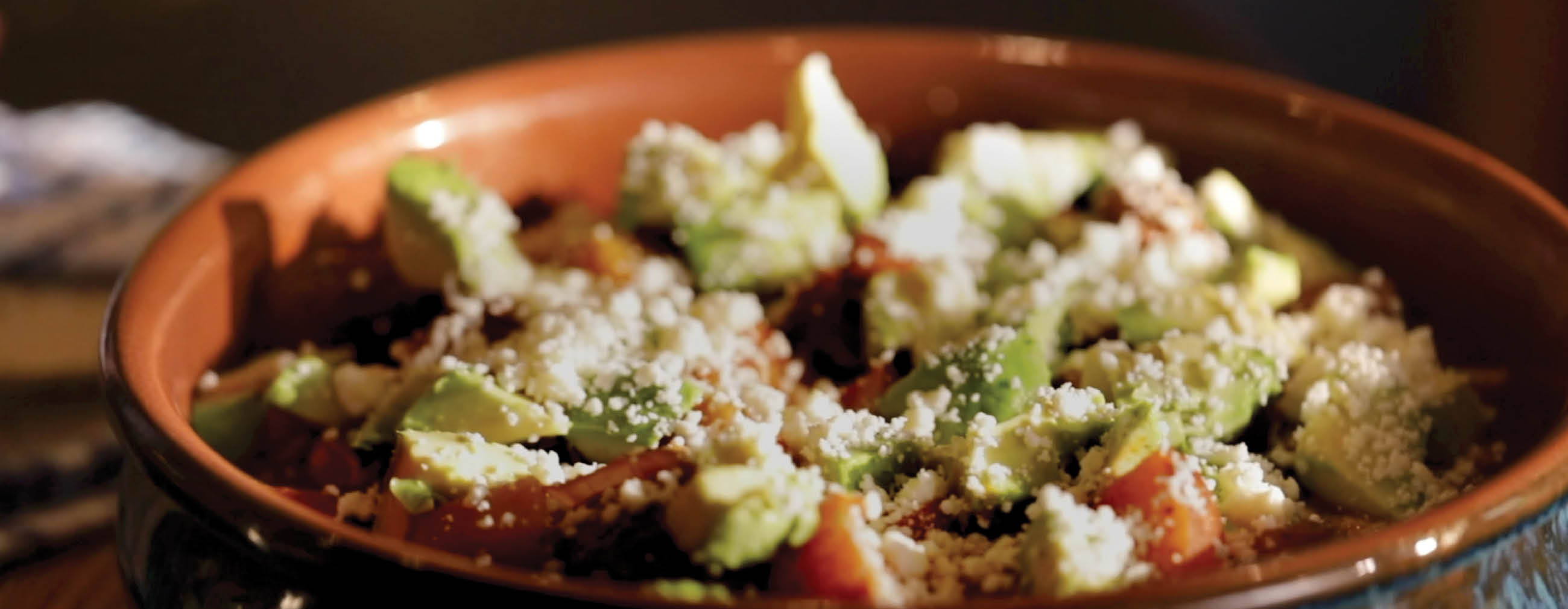 Pork Tinga with Potatoes, Avocado, and Fresh Cheese