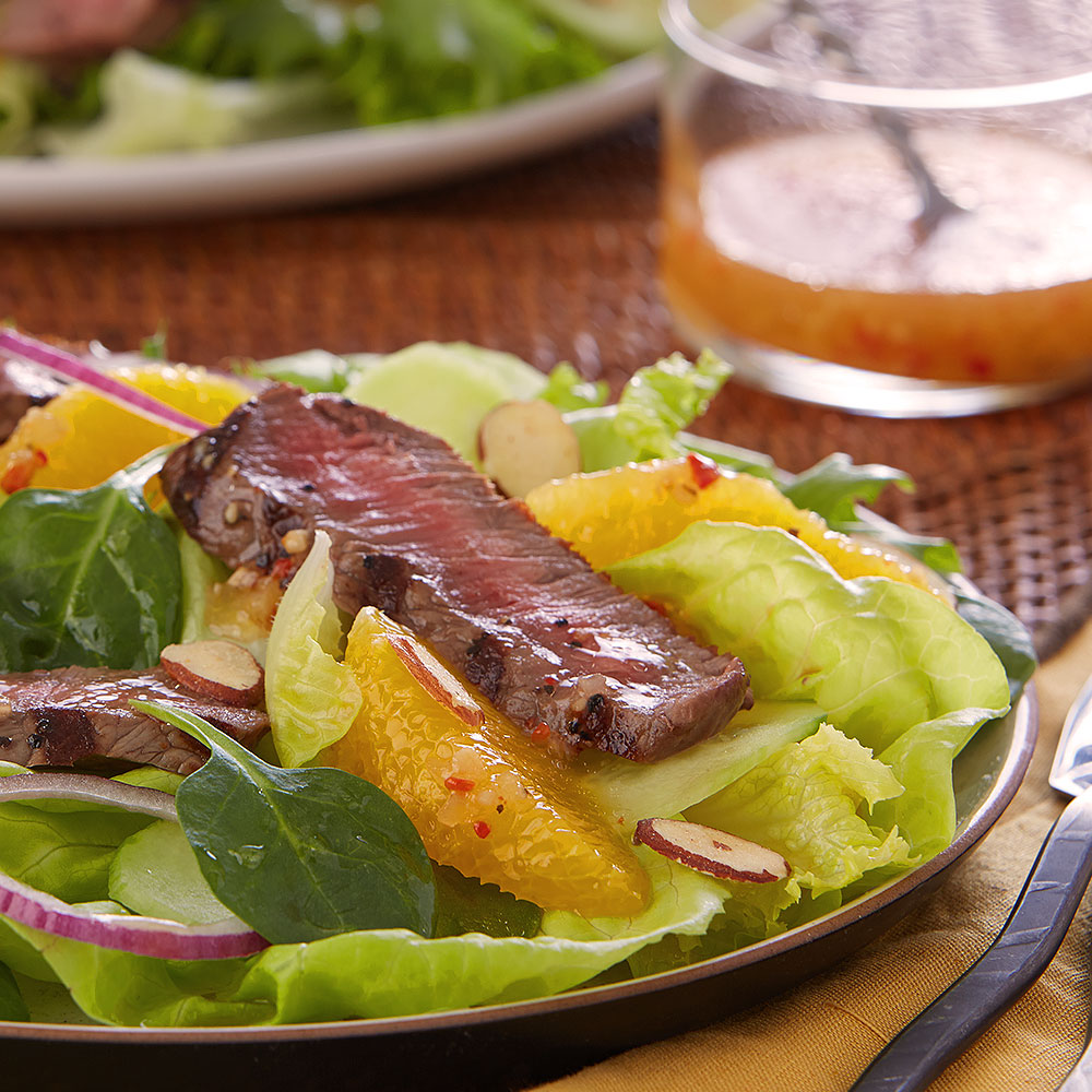 Beef with Oranges & Cucumber over Greens