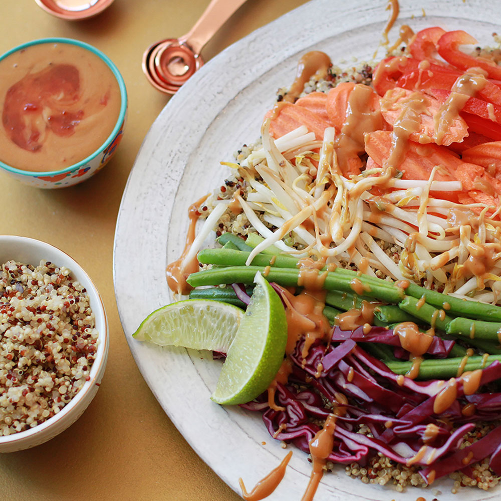Protein-Packed Vegetable Quinoa Bowl with Spicy Peanut Sauce